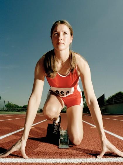 Runner Crouching at Starting Line